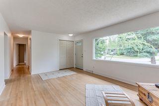 Photo 5: 8228 5 Street SW in Calgary: Kingsland Detached for sale : MLS®# A1124173