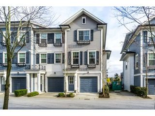 """Photo 1: 29 7348 192A Street in Surrey: Clayton Townhouse for sale in """"KNOLL"""" (Cloverdale)  : MLS®# R2100278"""