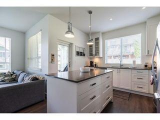 """Photo 6: 304 16396 64 Avenue in Surrey: Cloverdale BC Condo for sale in """"The Ridgse and Bose Farms"""" (Cloverdale)  : MLS®# R2579470"""