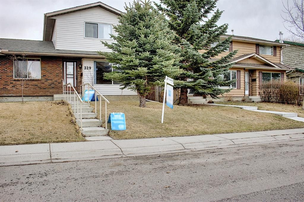 Main Photo: 329 Woodvale Crescent SW in Calgary: Woodlands Semi Detached for sale : MLS®# A1093334
