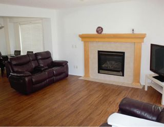 Photo 4: 72 Covepark Drive NE in Calgary: Coventry Hills Detached for sale : MLS®# A1105151