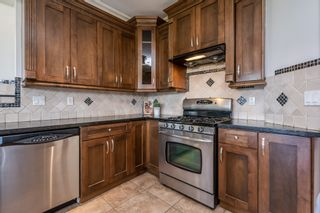 Photo 16: 6868 CLEVEDON Drive in Surrey: West Newton House for sale : MLS®# R2490841