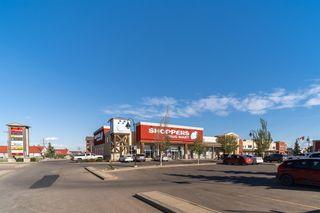 Photo 48: 105 Glenbrook Road: Cochrane Detached for sale : MLS®# A1124440
