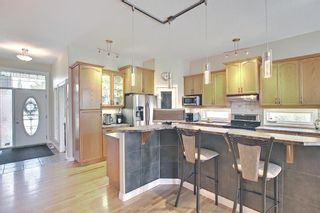 Photo 3: 31 Strathlea Common SW in Calgary: Strathcona Park Detached for sale : MLS®# A1147556