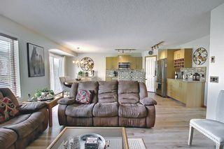 Photo 16: 140 Douglas Ridge Green SE in Calgary: Douglasdale/Glen Detached for sale : MLS®# A1114470