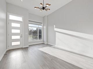 Photo 4: 2806 Edmonton Trail NE in Calgary: Winston Heights/Mountview Row/Townhouse for sale : MLS®# A1089576