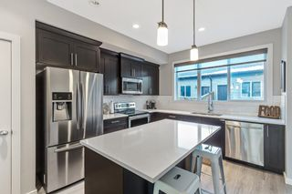 Photo 4: 1373 Legacy Circle SE in Calgary: Legacy Row/Townhouse for sale : MLS®# A1055779
