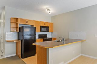 Photo 5: 94 Everridge Gardens SW in Calgary: Evergreen Row/Townhouse for sale : MLS®# A1069502
