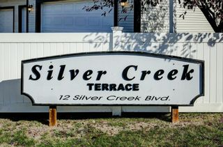 Photo 32: 17 12 Silver Creek Boulevard NW: Airdrie Row/Townhouse for sale : MLS®# A1153407