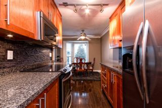 """Photo 5: 101 2615 LONSDALE Avenue in North Vancouver: Upper Lonsdale Condo for sale in """"HarbourView"""" : MLS®# V1078869"""