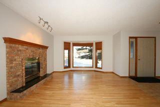 Photo 5: 22 WEST COPITHORNE Place: Cochrane House for sale : MLS®# C4121744
