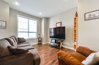Photo 2: 10 6075 SCHONSEE Way in Edmonton: Zone 28 Townhouse for sale : MLS®# E4242039