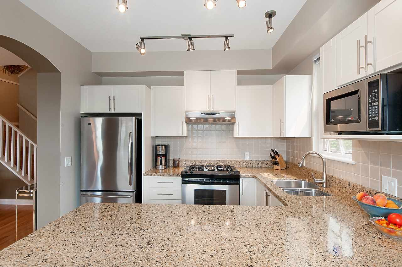 Stainless Steel appliances, new Cabinets & Silestone Counters enhance this spacious kitchen.