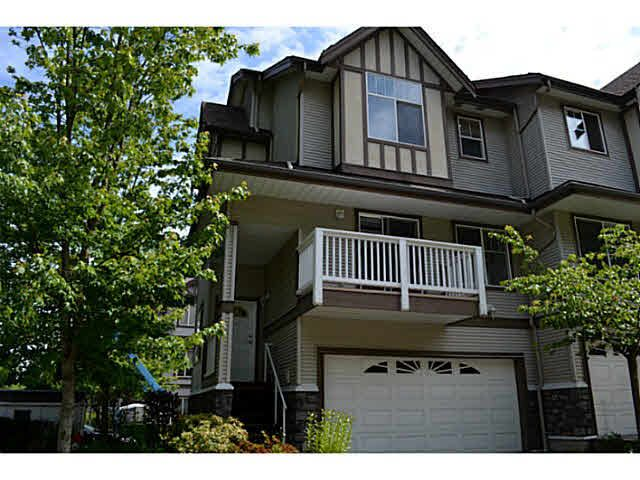 End unit with a 2 car side by side garage. Balconies front and back. Great location in the development.