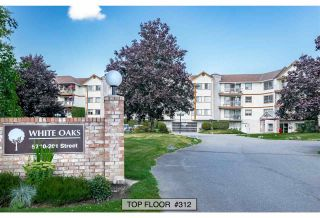 """Photo 1: 312 5710 201 Street in Langley: Langley City Condo for sale in """"WHITE OAKS"""" : MLS®# R2387162"""