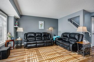 Photo 3: 100 Martinwood Road NE in Calgary: Martindale Detached for sale : MLS®# A1071596
