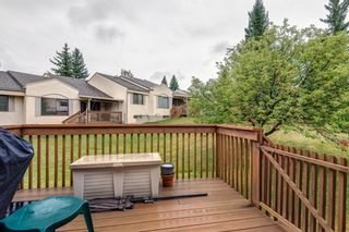 Photo 25: 71 Sandarac Circle NW in Calgary: Sandstone Valley Row/Townhouse for sale : MLS®# A1141051