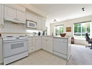 """Photo 8: 138 3098 GUILDFORD Way in Coquitlam: North Coquitlam Condo for sale in """"MARLBOROUGH HOUSE"""" : MLS®# V1081426"""