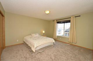 Photo 24: 41 BRIDLERIDGE Gardens SW in Calgary: Bridlewood House for sale : MLS®# C4135340