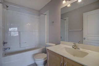 Photo 18: 76 Bridleridge Manor SW in Calgary: Bridlewood Row/Townhouse for sale : MLS®# A1106883