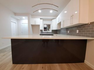 Photo 17: 1049 A Magnus Avenue South in Winnipeg: Shaughnessy Heights Residential for sale (4B)  : MLS®# 202124669