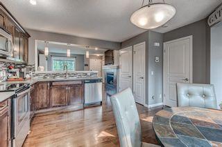 Photo 12: 61 Auburn Springs Boulevard SE in Calgary: Auburn Bay Semi Detached for sale : MLS®# A1135621
