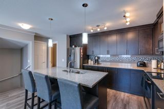 Photo 4: 203 Evanston Manor NW in Calgary: Evanston Row/Townhouse for sale : MLS®# A1149522