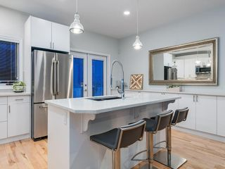 Photo 4: 415 20 Street NW in Calgary: Hillhurst Row/Townhouse for sale : MLS®# A1106275