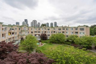 "Photo 1: 411 2995 PRINCESS Crescent in Coquitlam: Canyon Springs Condo for sale in ""PRINCESS GATE"" : MLS®# R2386105"