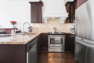 """Photo 2: 506 6480 195A Street in Surrey: Clayton Condo for sale in """"Salix"""" (Cloverdale)  : MLS®# R2341851"""