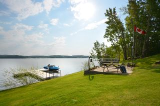 Photo 1: 13204 Lakeshore Drive in Charlie Lake: House for sale
