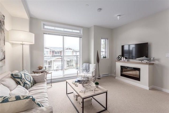 Enjoy over height ceilings, an electric fireplace and a balcony adjacent to the living room. Disclaimer: