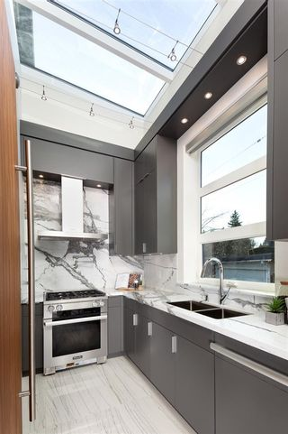 Photo 24: 2077 W 61ST Avenue in Vancouver: S.W. Marine House for sale (Vancouver West)  : MLS®# R2583083