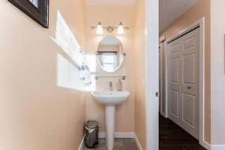 Photo 7: 1441 Ranchlands Road NW in Calgary: Ranchlands Row/Townhouse for sale : MLS®# A1061548