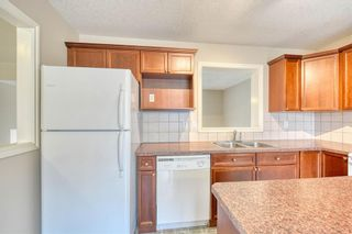 Photo 17: 66 Crystal Shores Cove: Okotoks Row/Townhouse for sale : MLS®# C4305435