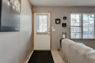 Photo 2: 104 3 EVERRIDGE Square SW in Calgary: Evergreen Row/Townhouse for sale : MLS®# A1143635