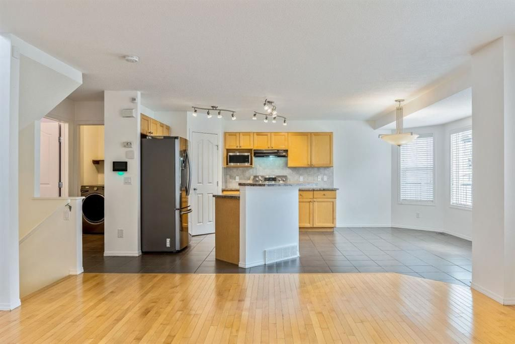 Photo 8: Photos: 53 Bridleridge Heights SW in Calgary: Bridlewood Detached for sale : MLS®# A1129360