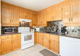 Photo 12: 19 Coachway Green SW in Calgary: Coach Hill Row/Townhouse for sale : MLS®# A1144999