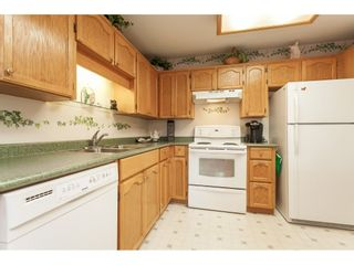 """Photo 22: 201 5375 205 Street in Langley: Langley City Condo for sale in """"Glenmont Park"""" : MLS®# R2482379"""