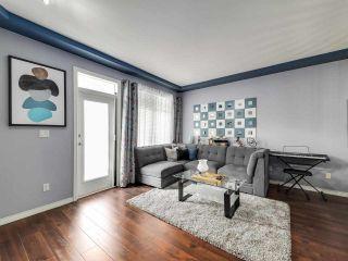 "Photo 3: 48 7250 144 Street in Surrey: East Newton Townhouse for sale in ""CHIMNEY RIDGE"" : MLS®# R2587185"