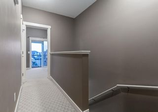 Photo 14: 106 WEST SPRINGS Road SW in Calgary: West Springs Row/Townhouse for sale : MLS®# A1128292