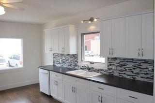 Photo 4: 1014 Nanton Avenue: Crossfield House for sale : MLS®# C4123826