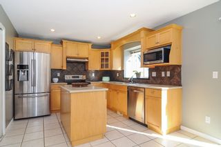 """Photo 6: 9424 203 Street in Langley: Walnut Grove House for sale in """"River Wynde"""" : MLS®# R2344514"""