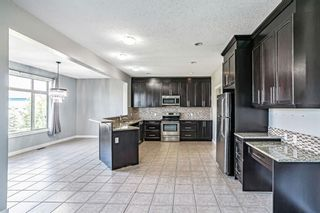 Photo 8: 121 Kinniburgh Boulevard: Chestermere Detached for sale : MLS®# A1147632