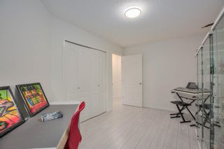 Photo 22: 412 30 Sierra Morena Mews SW in Calgary: Signal Hill Apartment for sale : MLS®# A1107918