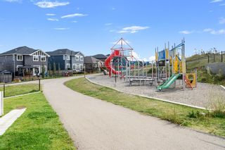 Photo 34: 1404 Jumping Pound Common: Cochrane Row/Townhouse for sale : MLS®# A1146897