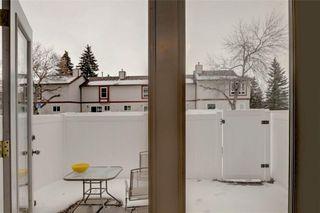 Photo 17: 203 DEERPOINT Lane SE in Calgary: Deer Ridge Row/Townhouse for sale : MLS®# C4288291