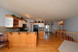 Photo 22: 303 GLENEAGLES View: Cochrane House for sale : MLS®# C4130061