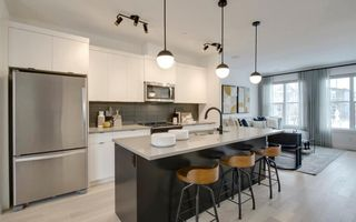 Photo 2: 133 Lucas Crescent NW in Calgary: Livingston Detached for sale : MLS®# A1047349