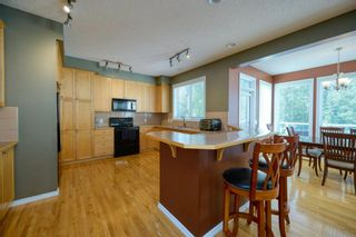 Photo 14: 323 Discovery Place SW in Calgary: Discovery Ridge Detached for sale : MLS®# A1141184